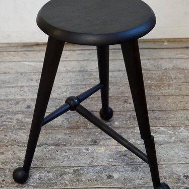 Ebonized ball foot stool