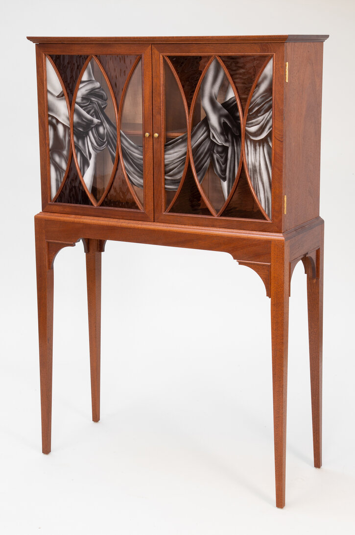 A Partially Draped Cabinet
