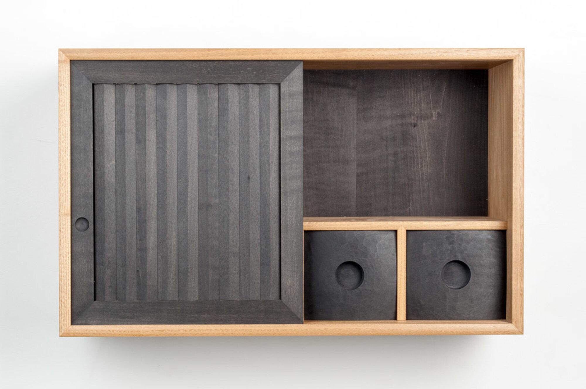 Pleated wall cabinet door open
